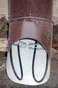 Нагрівальний кабель у водостічній трубі
