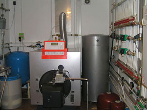 Газовый котел, подключенный к коллектору водяного теплого пола